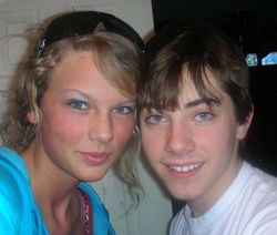 Taylor with another unknown guy at 16