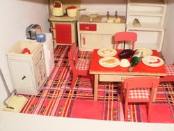 Kitchen with wrapping paper floor.