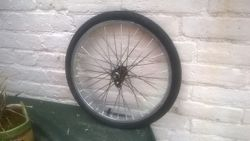 wheel partly sprayed with tyre on