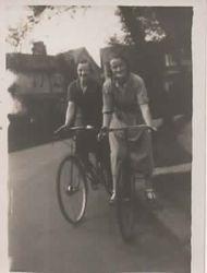 May & Stella on bikes.