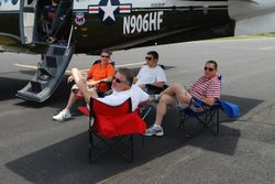Steve Welsh (far right) enjoys the shade with his passengers