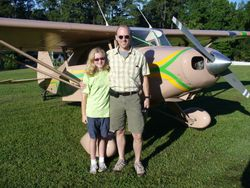 New member Dale Carter and his daughter Olivia in front of their recently acquired PA-20 Pacer.  Dale flies an Airbus for Fedex.