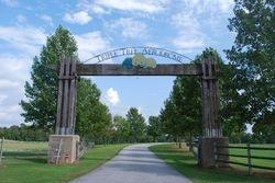 Entrance gate to Triple Tree