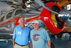 Pat Hartness, creator of Triple Tree with Ed Fisher, president of the Sport Aviation Association, in front of Pat's Spartan Executive