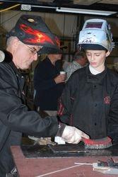 Terry Gardner explains to Brandon Troy the basics of arc welding.