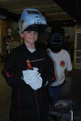 Brandon was very proud of his first bead.  Check out the neat homebuilder visor!