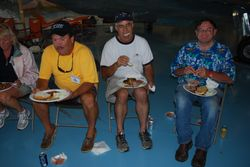 Jim Cronin, Terry Gardner and Konrad Schoen enjoy dinner Saturday