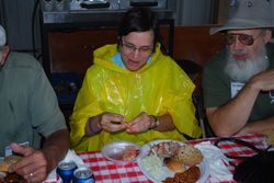Alison protected herself from the enthusiastic eater on her left, husband Chip