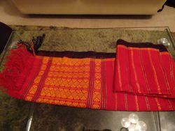 "A handmade Tanchangya traditional ""hadhi"" (scarf) with intricate designs"