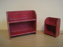 Two red and gold bookcases