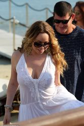 Mariah Carey donned a white kaftan that resembled a wedding gown on a romantic break in Mykonos