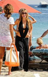 The 41-year-old matched the daring swimwear with a figure-hugging maxi-skirt as she strutted along a Mykonos beach