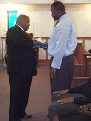 Franklin receiving his Graduation Bible