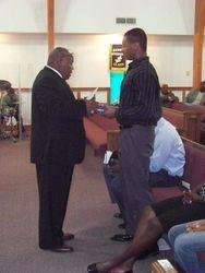 Ananias receiving his Graduation Bible