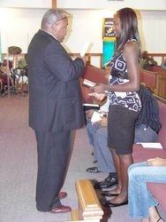 Cori receiving her Graduation Bible