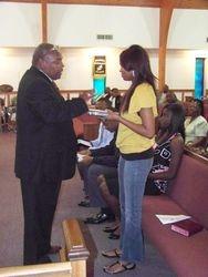 Alex receiving her Graduation Bible