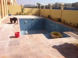 sand stone Deck area around pool