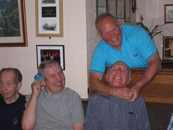 Strangle hold on Hack - Dicky, Jimmy, Les and Hack