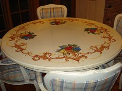 handpainted table with scrolls and floral