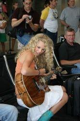 Taylor playing at an airport 1
