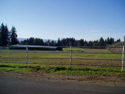 View from P-V Road of pastures & arena barn