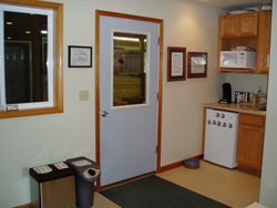 Office door to barn aisle, kitchen.
