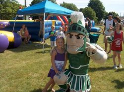 Sparty and a young fan