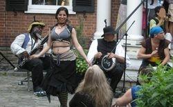 Members of Erratic Encampment performing