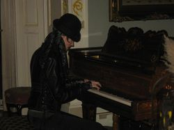 Jill Tracy playing one of the antique pianos in the castle.