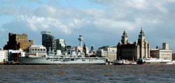 H.M.S. Illustrious with copter flying over
