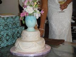 Bride cutting her cake