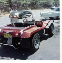 JJ O'Neil posing beside his Dune Buggy