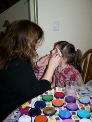 Jenn painting at a  birthday party