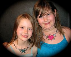 painted necklaces with y body glitter added
