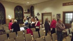Attenders mingle after the end of the service