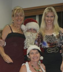 Anna, Julie and Mish with Santa