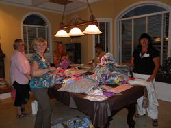 Chris, Vicki, Debbie, Kim and Lynn packing dresses with underwear