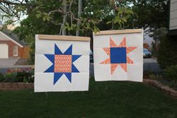 Broncos-colored wonky stars for guild outreach project