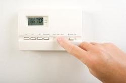 Set your thermostat at 68/55 in winter, 78 in summer.