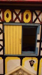 Blue plastic windows with yellow shutters