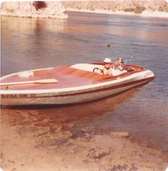 Me driving Dad's boat in the late 70's
