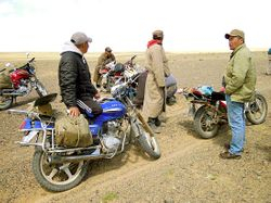 Tumen with group of bikers in the Gobi