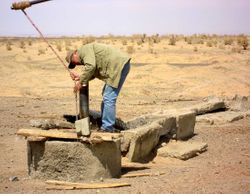 Tumen checking a well in the Gobi