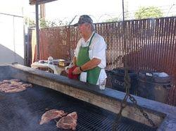 Big BBQ pit John loading up the steaks
