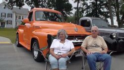 Ron Guadette and his wife Tina relax in front of their vintage 1954 Ford Pick-Up Truck.