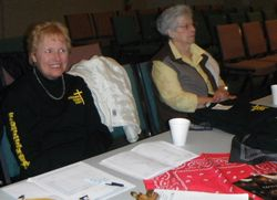 Gayle and Ruth attend the Swag Table....