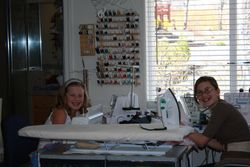 2 grand daughters busy working on projects.