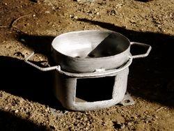 Charcoal burner made from old fridge motor. £18