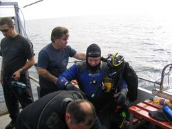 Skipper helps the tech divers with thier mixed gas rebreathers