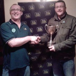 Eamon Mulholland presents Pat McGahan with the cup